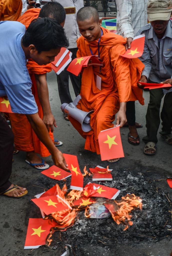 Burning paper Vietnamese flags.